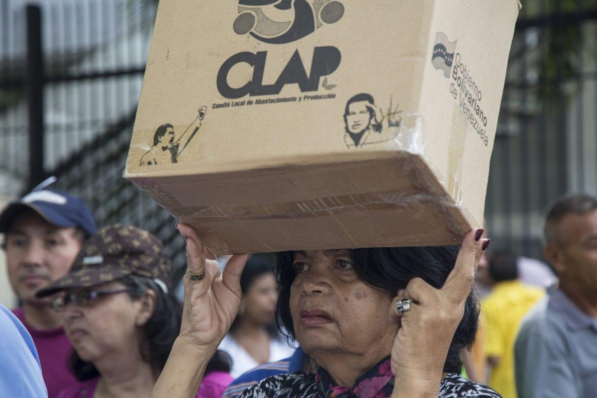 Imágen de protesta en Venezuela por cajas CLAP. Alex Saab. Nicolás Maduro